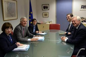 David Davis (right) with European Union Chief Negotiator in charge of Brexit negotiations with Britain Michel Barnier (2- left) during their meeting at the European Union Commission headquarter in Brussels, Belgium, on July 17, 2017.