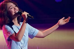 Singaporean Joanna Dong performing during a blind audition for the second season of Sing! China.