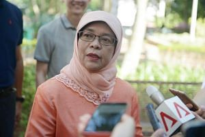 Speaker of Parliament Halimah Yacob joins residents of her Marsiling ward at the launch of their Orchid and Edible Gardens cum Hari Raya Celebration.