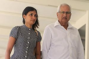 Ms Aarti Angara, sister of the deceased Radhika Angara, and her father leaving the State Courts on Tuesday (July 18).