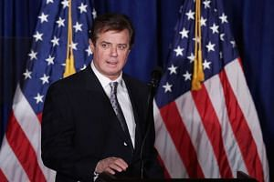 Paul Manafort, advisor to Republican presidential candidate Donald Trump's campaign, checks the teleprompters before Trump's speech at the Mayflower Hotel in Washington, DC on April 27, 2016.