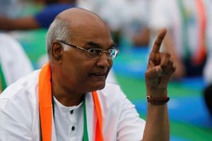 Ram Nath Kovind, nominated presidential candidate of India's ruling Bharatiya Janata Party (BJP), gestures as he attends an International Yoga Day event in New Delhi, India June 21, 2017.