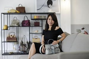 Ling Wu founder Goh Ling Ling 43, in her showroom at Holland Village with some of her bags. PHOTO: GIN TAY FOR THE STRAITS TIMES