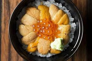 Sea urchin and salmon roe on rice.