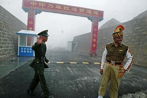 A 2008 photo of soldiers from China and India at the Nathu La border crossing between their countries in India's north- eastern Sikkim state. For the past month, India and China have been in a stand-off on the Doklam Plateau, which China says is part