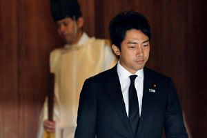 Mr Shinjiro Koizumi, a Japanese lawmaker from the ruling Liberal Democratic Party and son of former PM Junichiro Koizumi, leaves after visiting the Yasukuni Shrine in Tokyo, on Aug 15, 2013.