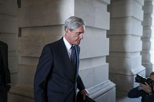 Mr Robert Mueller, the former FBI director and special counsel who is leading the Russia investigation, leaves the Capitol in Washington, on June 21, 2017.