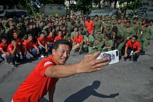 Second Minister for Defence Ong Ye Kung taking a selfie with the participants of the Dynamic Defence Display at the F1 Village on July 22, 2017.