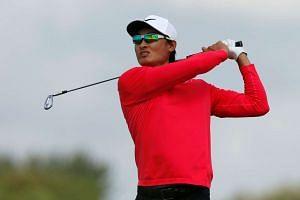 China's Haotong Li hits at tee shot on the second hole.