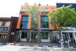 OCN is listed as having a Joo Chiat address, where a Malay wedding planning firm occupies most of the four-storey commercial building.