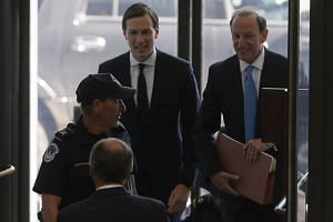 White House Senior Adviser Jared Kushner (centre) arrives for his appearance before a closed session of the Senate Intelligence Committee as part of their probe into Russian meddling in the 2016 US presidential election, on Capitol Hill in Washington