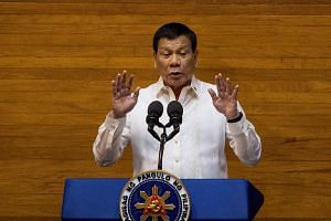 Philippine President Rodrigo Duterte gestures as he delivers his state of the nation address at Congress in Manila on July 24, 2017.