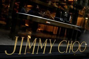 Michael Kors Holdings has agreed to buy luxury shoe brand Jimmy Choo for about £896 million (S$1.59 billion).