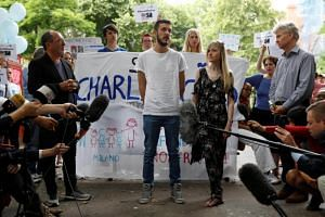The parents of critically ill baby Charlie Gard, Connie Yates and Chris Gard, speak to supporters and the media before handing in a petition to Great Ormond Street Hospital, in central London, Britain on July 9, 2017.