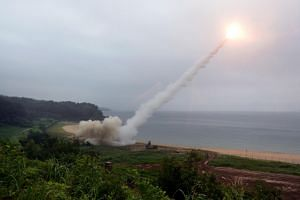 This handout photo taken on July 29, 2017, and provided by South Korean Defence Ministry in Seoul shows US Army Tactical Missile System (ATACMS) firing a missile into the East Sea from an undisclosed location on South Korea's east coast during a Sout