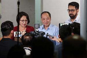 (From far left) Aljunied GRC MPs Sylvia Lim, Low Thia Khiang and Pritam Singh speaking to the media on the Aljunied- Hougang Town Council's lawsuit against them before Mr Low's Meet-the-People Session last Wednesday in Bedok Reservoir Road.