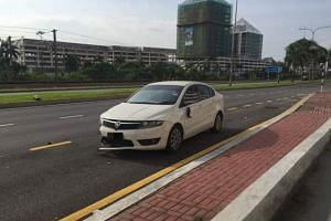 The victim quickly got into his car and pursued the suspect for about 3km before ramming his car into the latter's motorcycle near a traffic light.