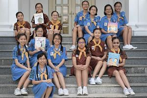 The books, by teams from (clockwise from bottom left) Methodist Girls' School, Holy Innocents' Primary School, River Valley High School and Haig Girls' School, mark the 100th anniversary of Girl Guides Singapore.