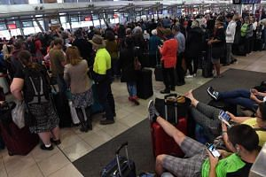 Long lines form at Sydney Airport's Terminal 2, a domestic terminal, on July 31, 2017, as passengers are subjected to increased security.