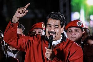 Venezuelan President Nicolas Maduro yesterday celebrating the outcome of a globally criticised election for an assembly to rewrite the Constitution.