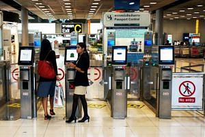 Visitors from Singapore and Hong Kong will be able to access the automated gates now reserved for Thai nationals at both of Bangkok's airports by the end of this month or next month.