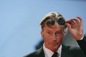 Sam Shepard adjusts his sunglasses as he arrives for a screening during the 2007 Venice International Film Festival.