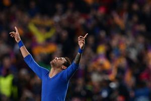 Barcelona's Brazilian forward Neymar celebrates their 6-1 victory at the end of the UEFA Champions League round of 16 second leg football match on March 8, 2017.