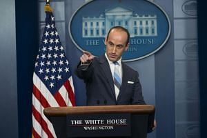 Stephen Miller, a senior adviser to President Donald Trump, fields questions from reporters during the daily briefing at the White House.