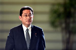 Fumio Kishida arriving at the prime minister's official residence to attend a cabinet meeting in Tokyo.