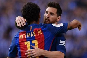 Neymar (left) celebrates with Lionel Messi after scoring during the Spanish Copa del Rey (King's Cup) final football match between FC Barcelona vs Deportivo Alaves.