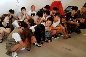 These Chinese nationals were among the 215 suspects arrested for allegedly running an online scam from Cambodia. The victims in China were tricked into sending nude photos, only to be blackmailed by the gang.