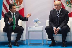 Mexican President Enrique Pena Nieto and his US counterpart Donald Trump meeting on the sidelines of the G-20 summit in Germany last month. According to transcripts of their earlier Jan 27 conversation, Mr Trump urged Mr Pena Nieto not to say to the