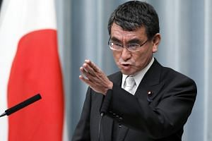 Newly appointed Japanese Foreign Minister Taro Kono speaks during a news conference at prime minister's official residence in Tokyo.