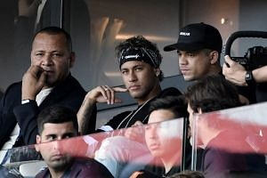 PSG's Neymar (centre) watches his new team play Amiens, Aug 5 2017.