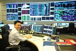 Energy Market Authority control manager Derrick Lim in a room that oversees the transmission of high-voltage power.