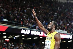 Usain Bolt of Jamaica waves to spectators after the men's 100m final at the London 2017 IAAF World Championships in London.