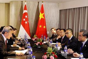 China's Foreign Minister Wang Yi (right) and counterpart from Singapore Vivian Balakrishnan hold bilateral meeting on the sidelines of the 50th Association of Southeast Asia Nations (ASEAN) Regional Forum (ARF) in Manila, Philippines on Aug 6, 2017.