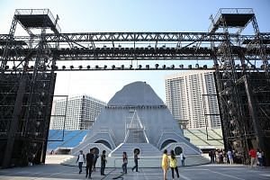 """Performers will scale the """"mountain"""", which will make an appearance in the final act of the show, symbolising how Singapore conquers challenges. It is located between two movable LED screens that can be combined."""