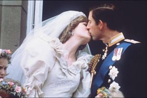 Princess Diana and Prince Charles kissing during their wedding on July 29, 1981.