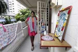 Madam Veerama at her corridor in Marine Terrace.