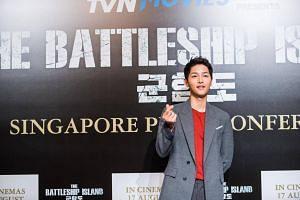 Song Joong Ki at the press conference at Marina Bay Sands to promote his new wartime movie, The Battleship Island.