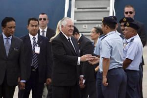 US Secretary of State Rex Tillerson (centre) is welcomed as he arrives at the Royal Malaysian Air Force base in Subang, on Aug 8, 2017.