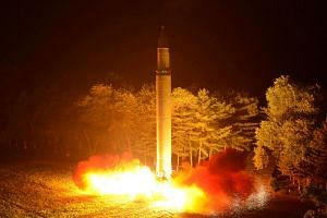 The North Korean intercontinental ballistic missile Hwasong-14 is pictured during its second test-fire in an undated picture.