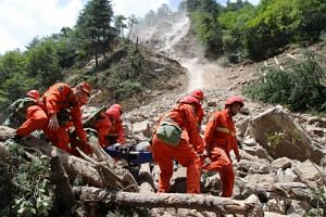 Rescue workers carry a survivor after an earthquake in Jiuzhaigou county, Ngawa prefecture, Sichuan province, China on Aug 9, 2017.