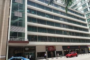 Afro Asia Building, a commercial building in Robinson Road, has smoke detectors, a fire alarm system, fire hoses and a fire lift. People's Park Centre has an automatic fire sprinkler system, a wet riser system, an automatic fire alarm system, as well