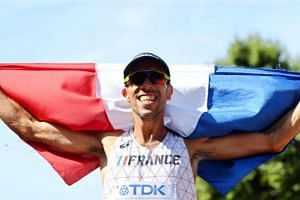 France's Yohann Diniz celebrates after winning the men's 50km Race Walk at the London 2017 IAAF World Championships in central London, Britain on Aug 13, 2017.
