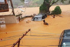 This handout picture released on August 14, 2017, by Society 4 Climate Chnage Communication Sierra Leone, shows flooded streets in Regent near Freetown. The death toll from massive flooding in the Sierra Leone capital of Freetown climbed to 312 on A