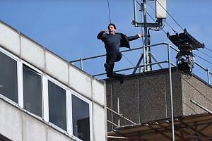 Actor Tom Cruise was seen limping after hitting the wall of a building on the London set of Mission: Impossible 6 on Sunday.