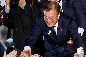 Mr Moon Jae In thanking supporters at Gwanghwamun Square in Seoul on May 10, when he assumed office as South Korean President.