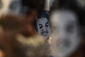 """Activists wearing masks of Thai human rights activist Jatupat """"Pai"""" Boonpattararaksa during a demonstration in Bangkok."""